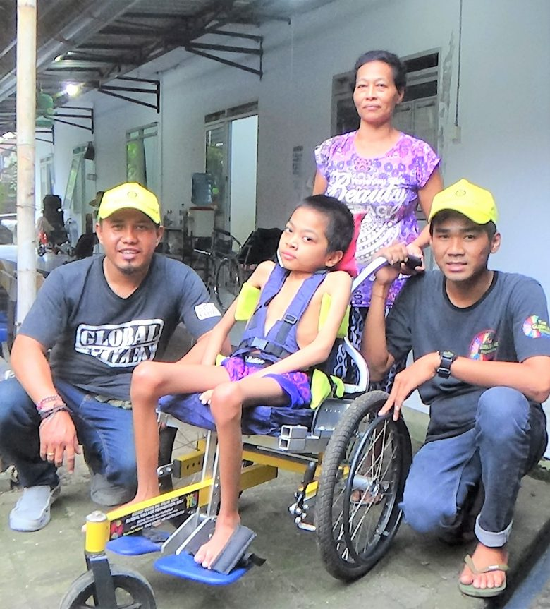 A new wheelchair for Komang. age 12